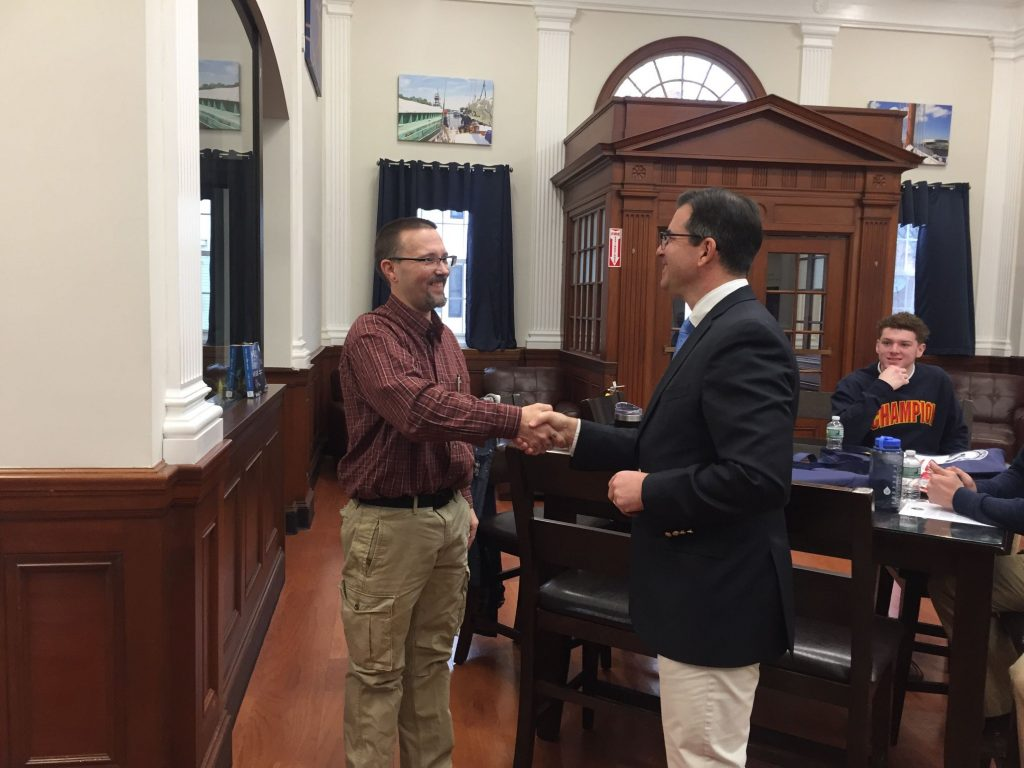 Northeast Maritime Institute President Eric Dawicki Issues Challenge Coins